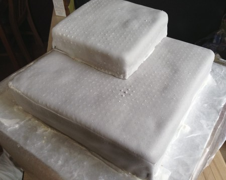 cake covered in lego textured marshmallow fondant