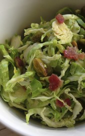 Shaved Brussels Sprouts Salad with Pistachios & Warm Maple-Bacon Vinaigrette