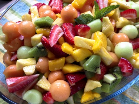 Tropical fruit salad with ginger-mint dressing