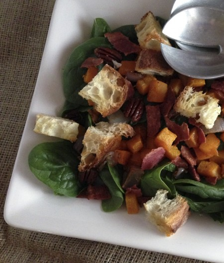 spinach salad with maple-roasted butternut squash, bacon, and pecans