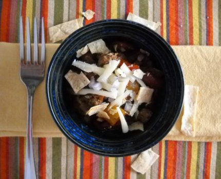 recipe for slow cooker chili made with Mexican chorizo sausage and beans